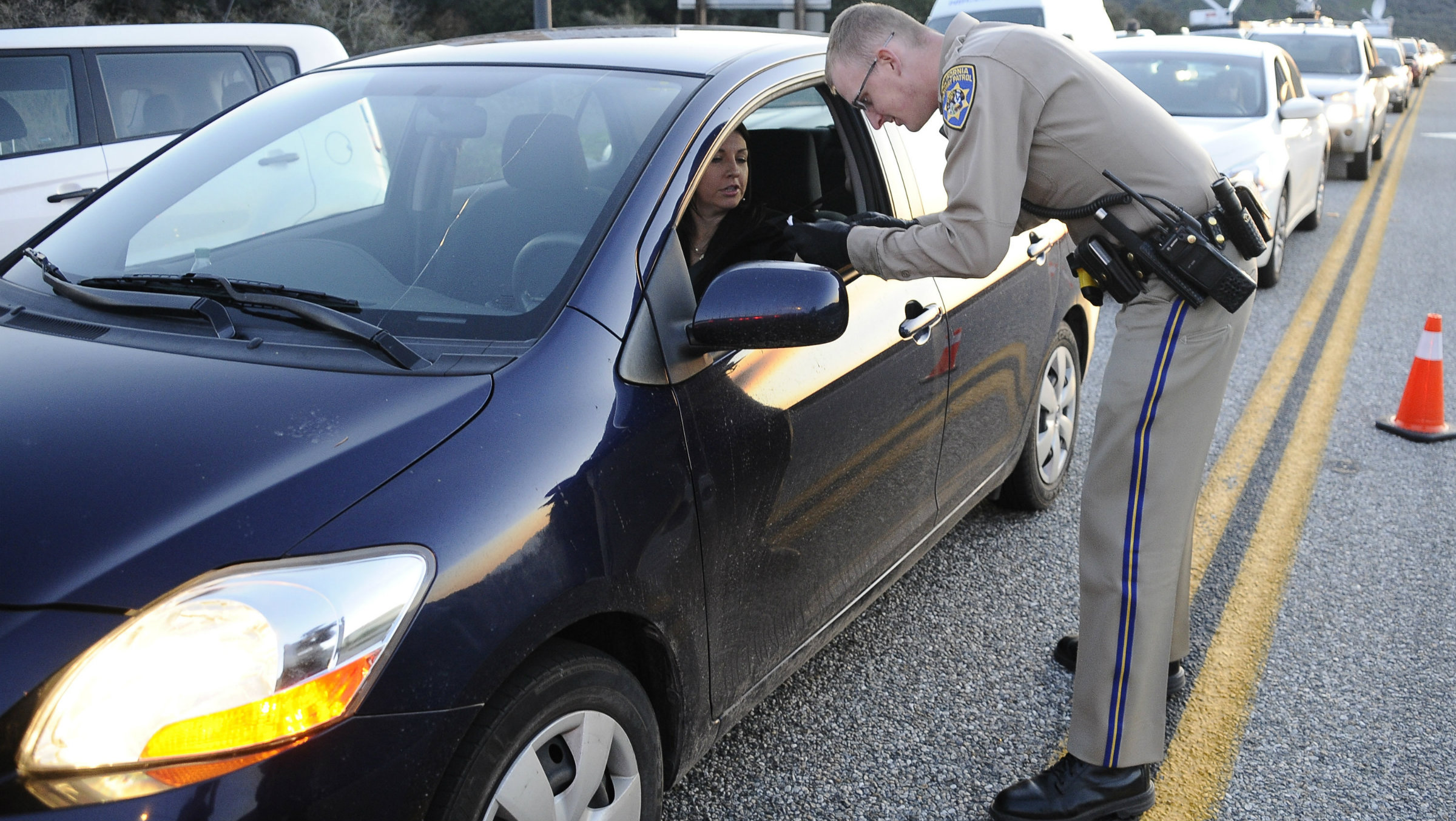 Police checking a driver's license.