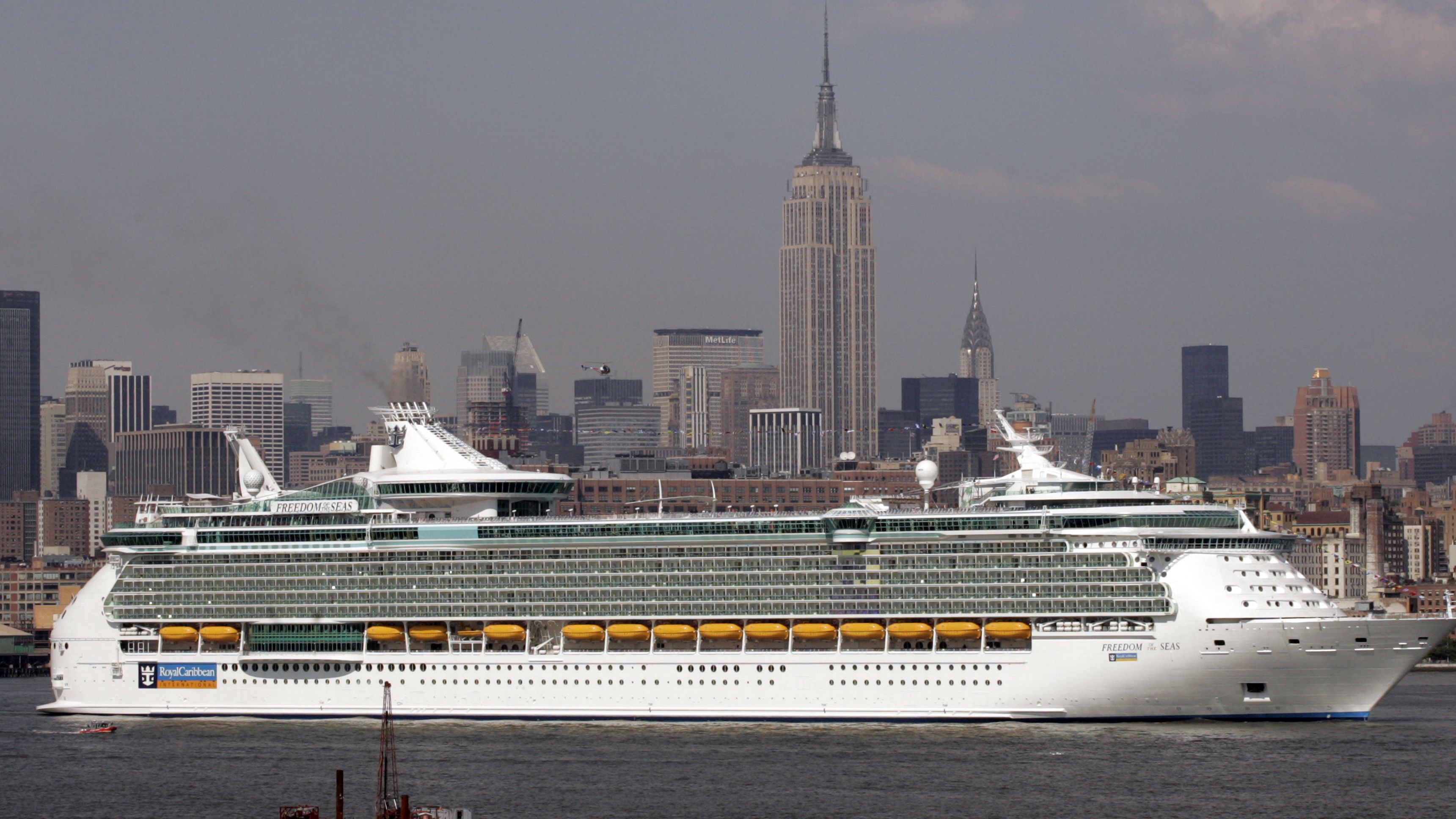 The Cruise ship 'Freedom of the Seas' makes its way down New York Harbor near the Empire State Building in New York May 13, 2006. At 158,000 tons, the Freedom of the Seas is the world's largest passenger ship.REUTERS/Keith Bedford