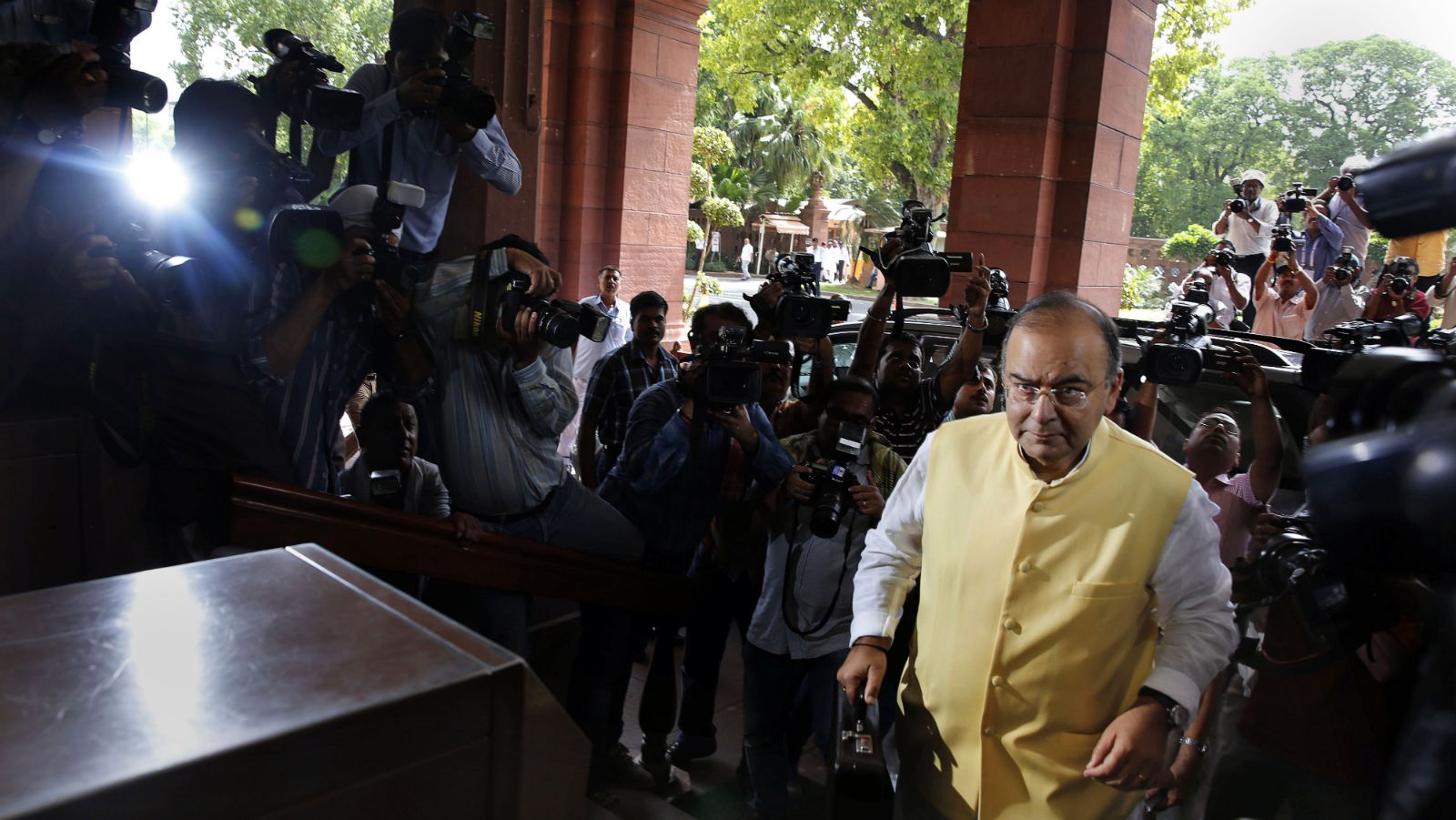 Indian Finance Minister Arun Jaitley arrives to present the 2014-15 union budget at the Indian parliament in New Delhi, Thursday, July 10, 2014. India's new government has introduced an ambitious reform-minded budget focusing on promoting manufacturing and infrastructure, raising the tax base and overhauling populist subsidies.