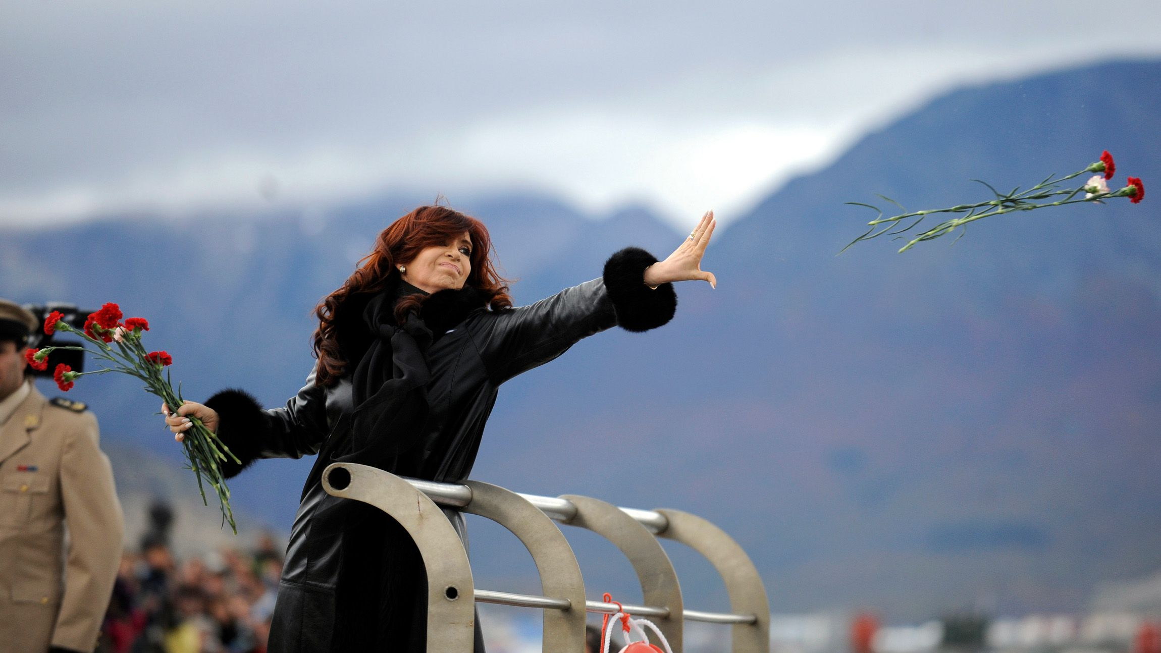"""Argentine President Cristina Fernandez de Kirchner throws flowers into the Bahia de Ushuaia (Ushuaia Bay) waters to pay homage to the fallen soldiers during the Falklands War in Ushuaia April 2, 2012. April 2 marks the 30th anniversary of the war over the Falkland islands, known commonly in Argentina as """"Las Malvinas"""". Thirty years after Britain and Argentina went to war over the Falklands, relations are at their chilliest in years as Buenos Aires launches a multi-pronged diplomatic offensive to assert its claim to sovereignty over the South Atlantic islands."""
