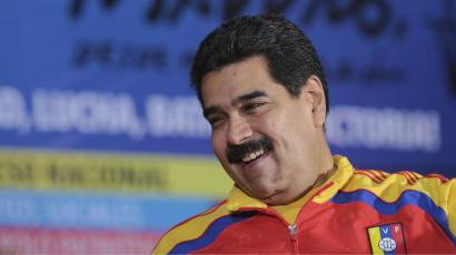 Venezuela's President Nicolas Maduro smiles during a meeting with the political alliance Gran Polo Patriotico (Great Patriotic Pole) in Caracas in this November 8, 2014 photo.