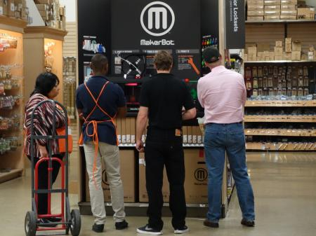 home depot employees looking at a MakerBot display