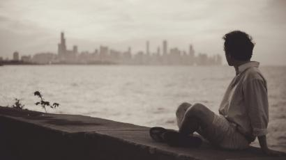 man looking wistfully at a city