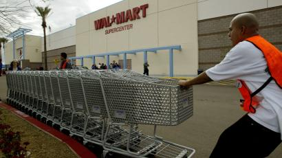 men moving carts at walmart