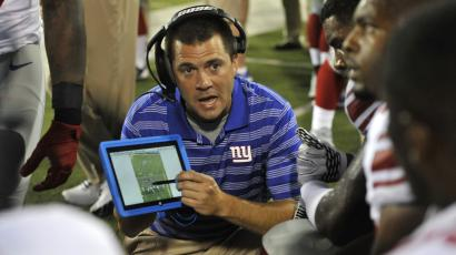 New York Giants tight ends coach Kevin Gilbride uses a Microsoft Surface tablet at the Pro Football Hall of Fame exhibition NFL football game against the Buffalo Bills Sunday, Aug. 3, 2014, in Canton, Ohio. New York won 17-13. (AP Photo/David Richard)