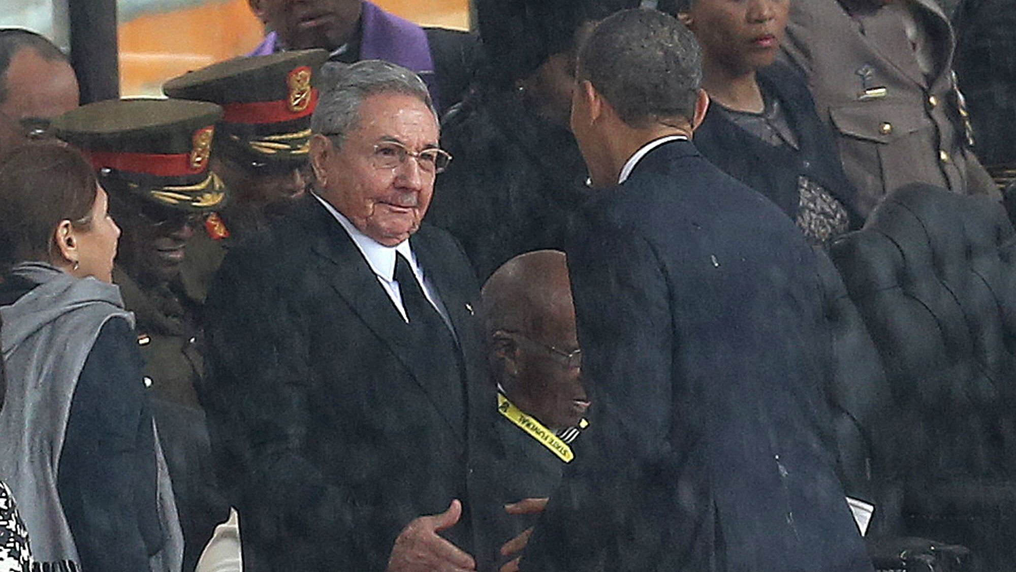 Raul Castro and Barack Obama shake hands at Nelson Mandela's funeral.