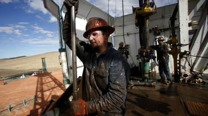 Roughneck Brian Waldner is covered in mud and oil while wrestling pipe on a True Company oil drilling rig outside Watford, North Dakota, October 20, 2012. Thousands of people have flooded into North Dakota to work in state's oil drilling boom. REUTERS/Jim Urquhart (UNITED STATES - Tags: ENERGY BUSINESS)