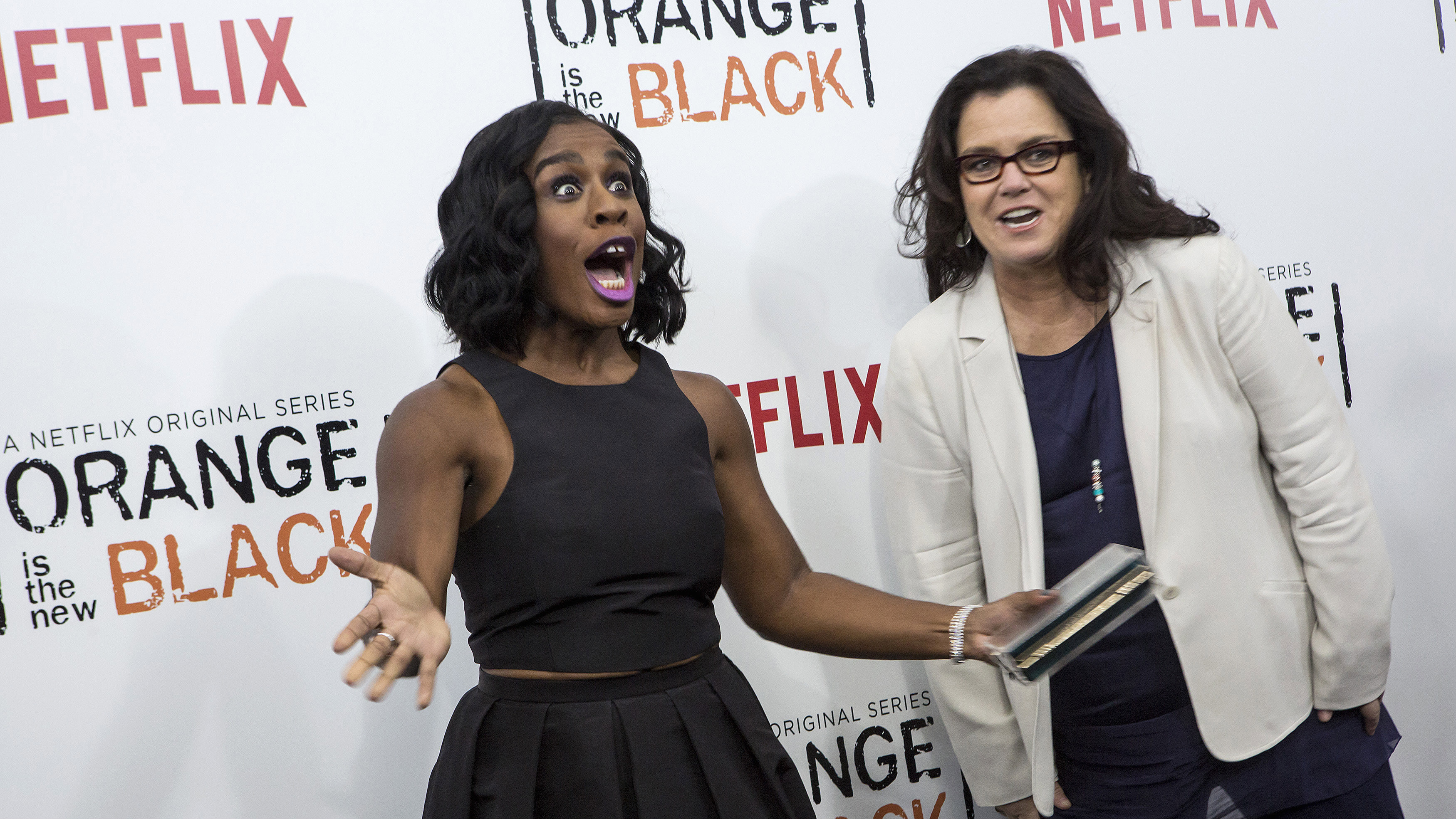 """Cast member Uzo Aduba reacts to seeing comedian Rosie O'Donnell at the season two premiere of """"Orange is the New Black"""" in New York May 15, 2014."""