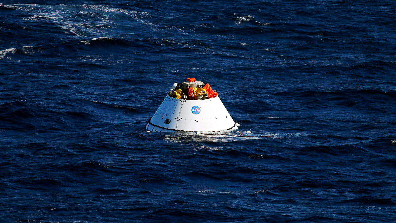 A test version of NASA's Orion capsule floats in the ocean during a recovery drill off the coast of California September 15, 2014. Orion is NASA's next exploration spacecraft, designed to carry astronauts to destinations in deep space, including an asteroid and Mars. Picture taken September 15, 2014.