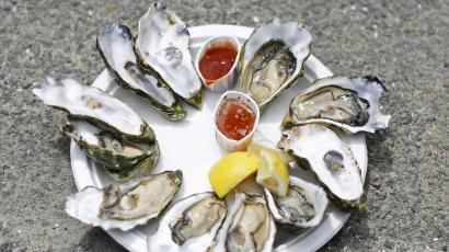 A plate of oysters is seen at Drakes Bay Oyster Company in Inverness, California July 31, 2014. The third-generation, family-owned oyster farm will be forced to shut its oyster shack and cannery on July 31 after losing a 19 month legal battle with the federal government. The Department of the Interior declined to renew the farm's lease in efforts to restore the area, also known as Drakes Estero within the Point Reyes National Seashore, to a state of marine wilderness as designated by the U.S. Congress in 1976. The case was denied an appeal by the U.S. Supreme Court on June 30 which upheld a decision by the 9th U.S. Circuit Court of Appeals to rule against the oyster company. However, the farm's harvesting operations will be permitted to continue for at least another 30 days after a group of local restaurants and businesses filed a new lawsuit and forged an agreement with the National Park Service to allow it to harvest until the court's ruling on the injunction. REUTERS/Stephen Lam