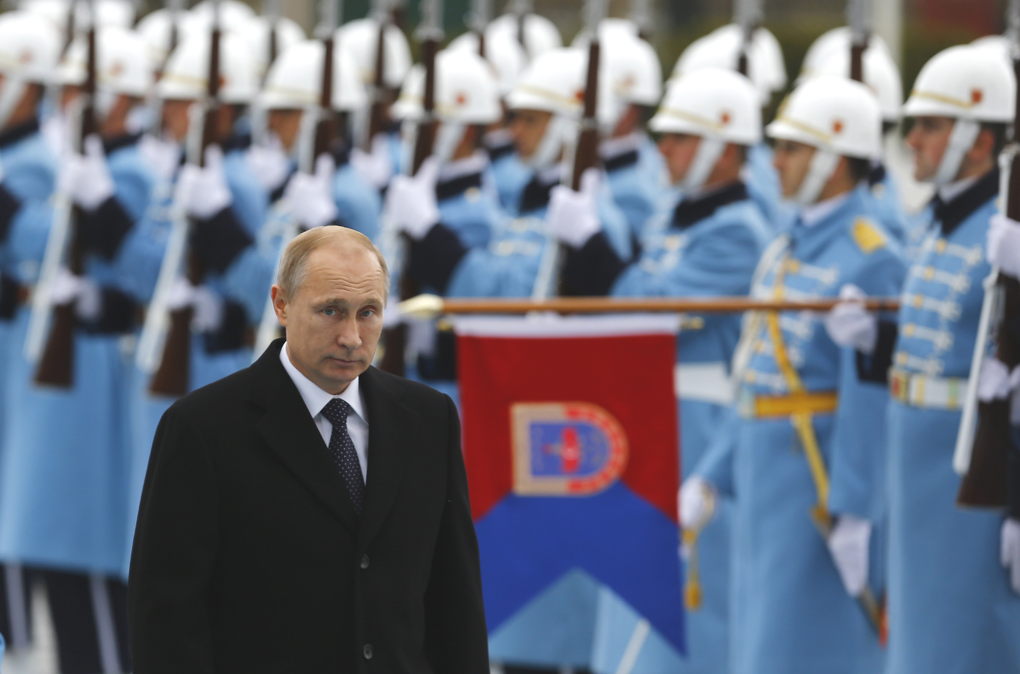Russia's President Vladimir Putin reviews a guard of honour during a welcoming ceremony at the Presidential Palace in Ankara, December 1, 2014.