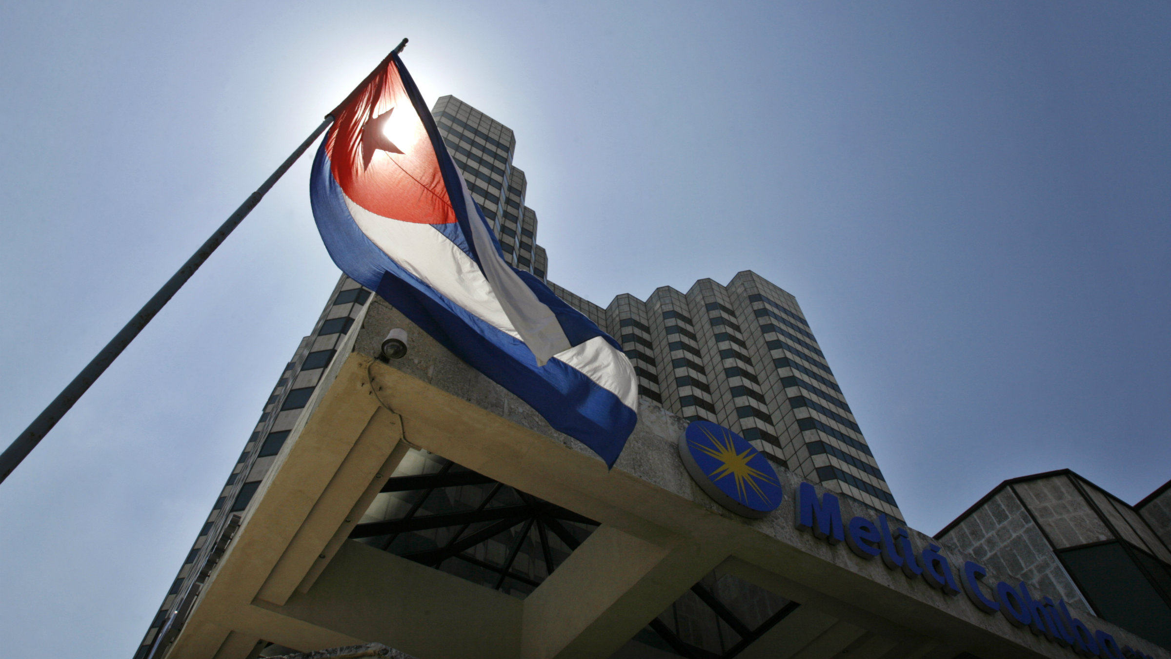 The Cuban flag stands outside a hotel of the Spanish Melia hotel chain in Havana.