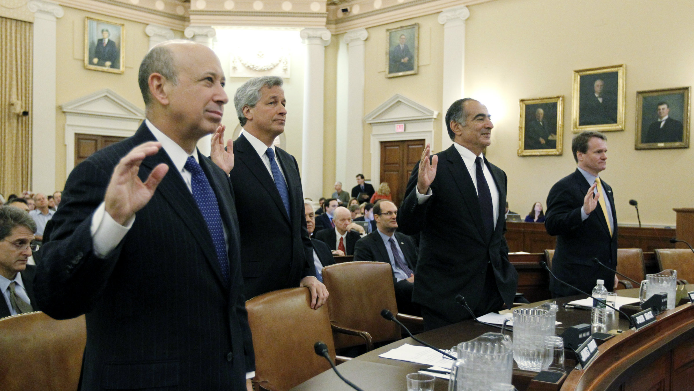 From left to right, Lloyd Blankfein, chief executive of Goldman Sachs Group, Jamie Dimon, chief executive of JPMorgan Chase, John Mack, chairman of Morgan Stanley, and Brian Moynihan, chief executive of Bank of America are sworn in before their testimony at the Financial Crisis Inquiry Commission (FCIC) and its first public hearing in Washington January 13, 2010.