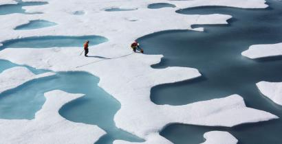The crew of the U.S. Coast Guard Cutter Healy, in the midst of their ICESCAPE mission, retrieves supplies for some mid-mission fixes dropped by parachute from a C-130 in the Arctic Ocean in this July 12, 2011 NASA handout photo obtained by Reuters June 11, 2011. Scientists punched through the sea ice to find waters richer in phytoplankton than any other region on earth. Phytoplankton, the base component of the marine food chain, were thought to grow in the Arctic Ocean only after sea ice had retreated for the summer. Scientists now think that the thinning Arctic ice is allowing sunlight to reach the waters under the sea ice, catalyzing the plant blooms where they had never been observed. REUTERS/Kathryn Hansen/NASA (UNITED STATES - Tags: ENVIRONMENT SCIENCE TECHNOLOGY) THIS IMAGE HAS BEEN SUPPLIED BY A THIRD PARTY. IT IS DISTRIBUTED, EXACTLY AS RECEIVED BY REUTERS, AS A SERVICE TO CLIENTS. FOR EDITORIAL USE ONLY. NOT FOR SALE FOR MARKETING OR ADVERTISING CAMPAIGNS - RTR33FOY