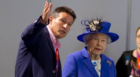 Britain's Queen Elizabeth visits the aquatics centre with London 2012 Olympic Games Chief Lord Seb Coe in London July 28, 2012. REUTERS/Neil Hall (BRITAIN - Tags: SPORT OLYMPICS ROYALS SWIMMING) - RTR35GU6