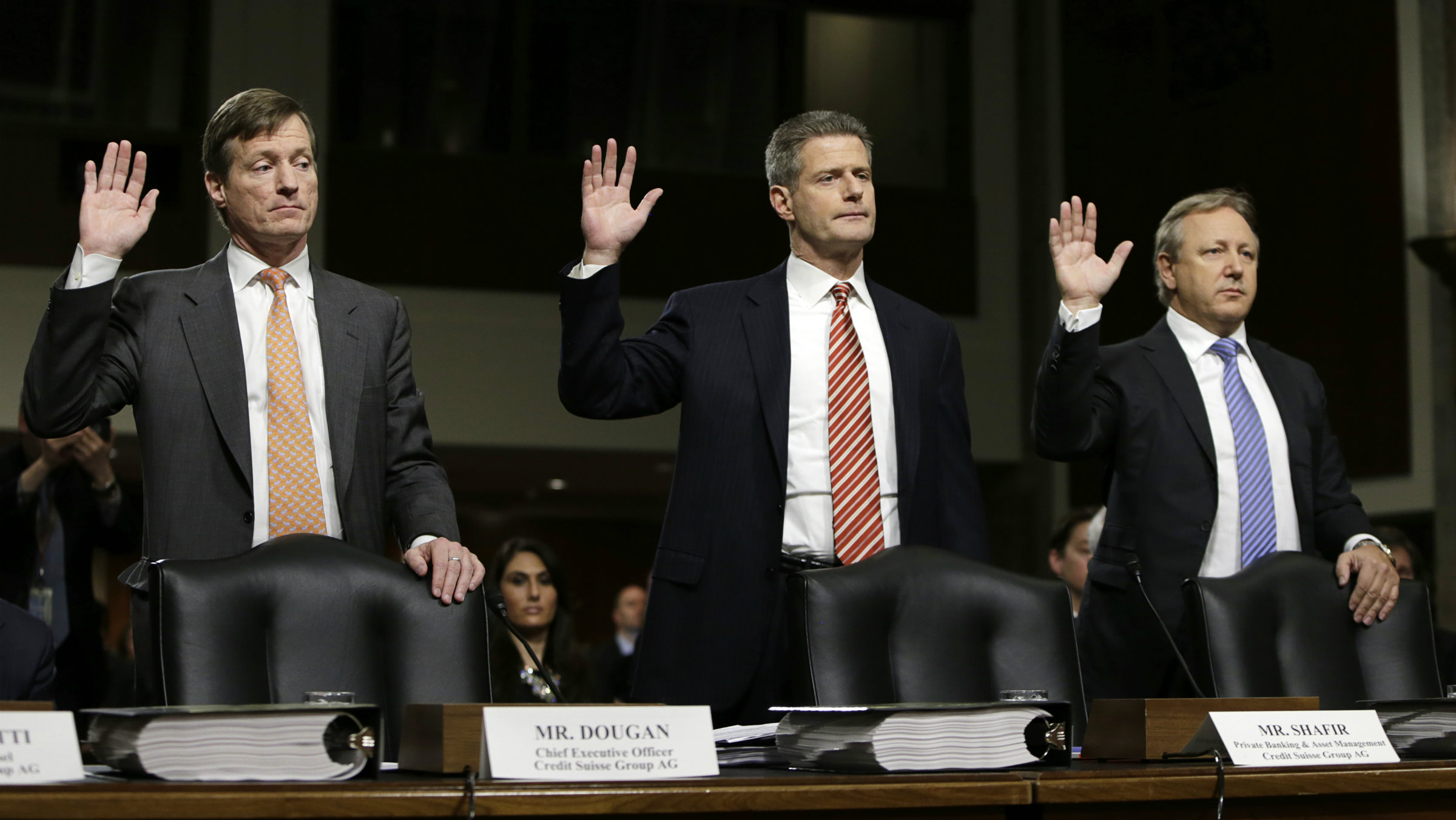(L-R) Credit Suisse officials CEO Brady Dougan, Robert Shafir and Hans Urlich-Mesiter are sworn in before the Senate Homeland and Governmental Affairs Investigations Subcommittee on Capitol Hill in Washington February 26, 2014.