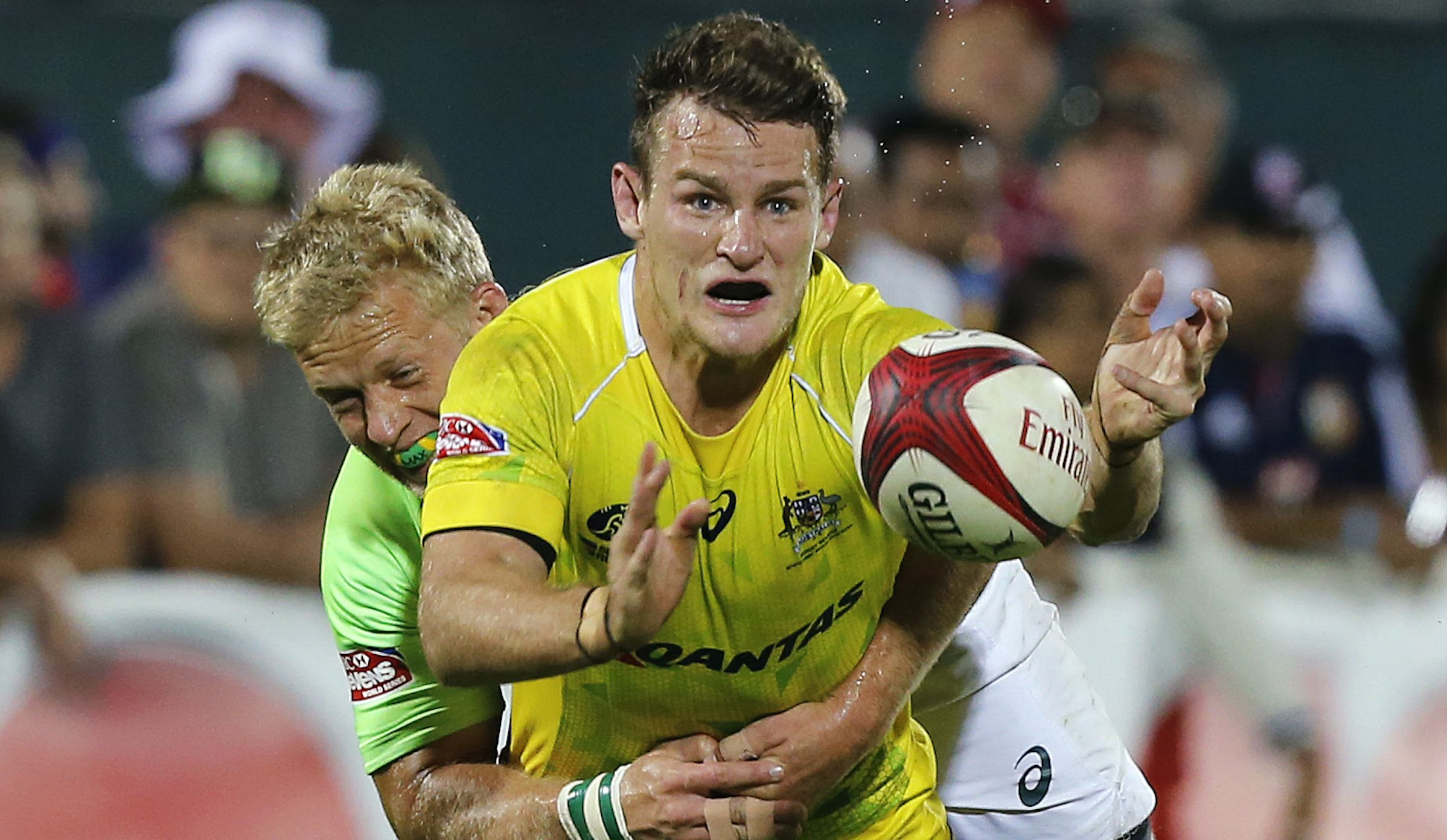 Australia's Con Foley is tackled by South Africa's Kyle Brown during their Sevens World Series final rugby match in Dubai December 6, 2014. REUTERS/Ahmed Jadallah (UNITED ARAB EMIRATES - Tags: SPORT RUGBY) - RTR4GYPL