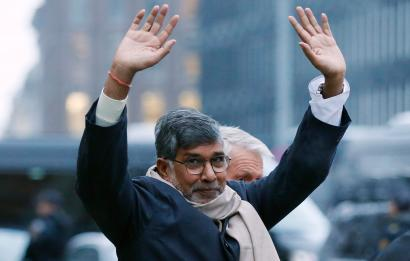 Nobel Peace Prize laureate Satyarthi waves to a crowd gathered outside following a news conference in Oslo
