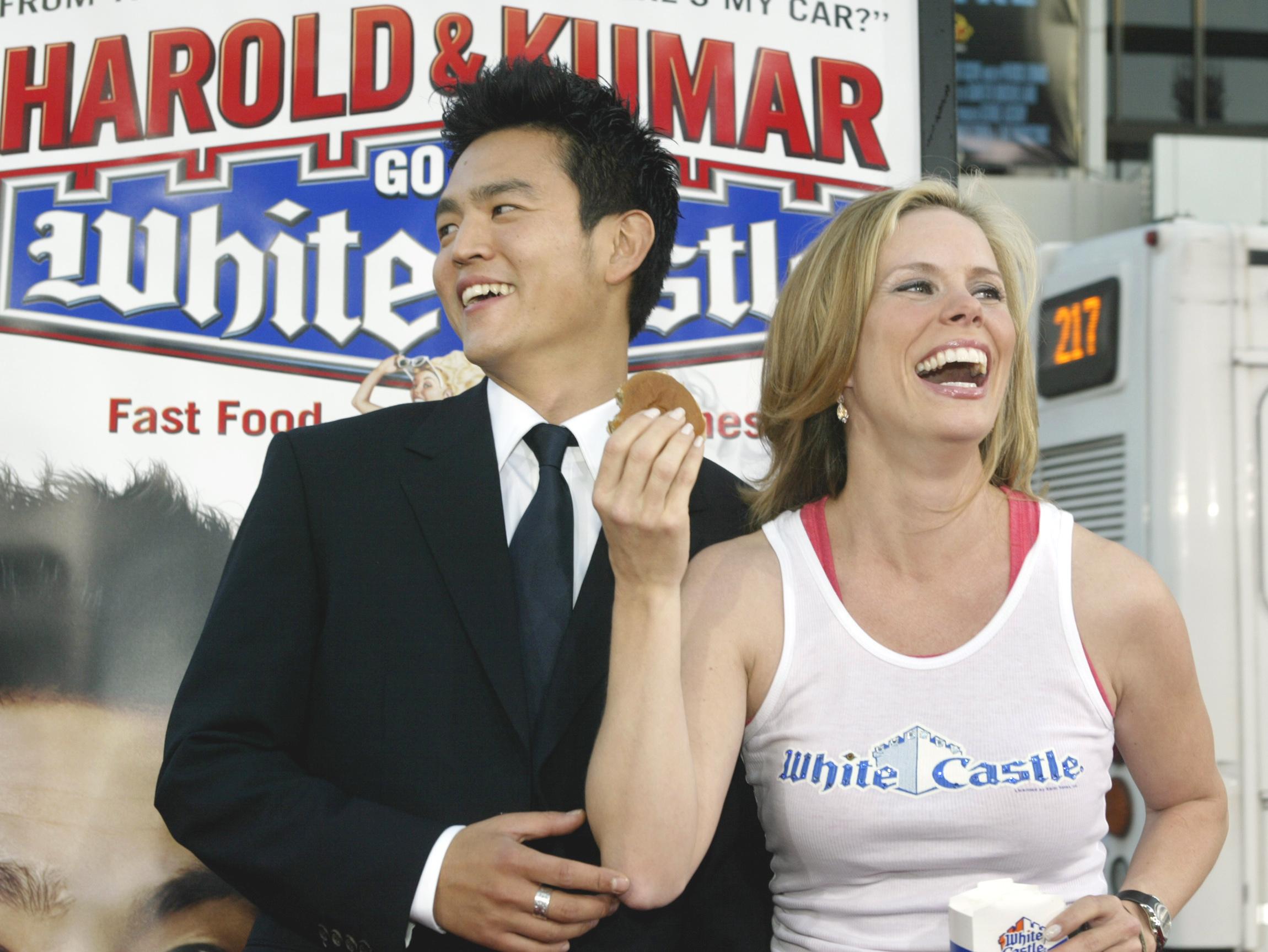 John Cho and Cheryl Hines at movie premiere