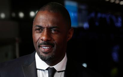 "Cast member Idris Elba, who portrays Nelson Mandela in the film, arrives for the Royal Premiere of ""Mandela: Long Walk to Freedom"" in London December 5, 2013. South African anti-apartheid hero Mandela died aged 95 at his Johannesburg home on Thursday after a prolonged lung infection, plunging his nation and the world into mourning for a man hailed by global leaders as a moral giant. REUTERS/Suzanne Plunkett (BRITAIN - Tags: ENTERTAINMENT POLITICS OBITUARY) - RTX165P4"