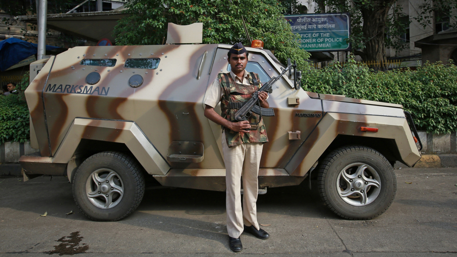 A Mumbai police constable poses as he stands guard next to an armoured vehicle outside the police commissioner's office in Mumbai October 1, 2014. When the killing of an unarmed black teenager by a white policeman in Ferguson, Missouri, in August sparked sometimes violent protests, the response of police in camouflage gear and armoured vehicles wielding stun grenades and assault rifles seemed more like a combat operation than a public order measure. Some U.S. police departments have recently acquired U.S. military-surplus hardware from wars abroad, but there are many law enforcers around the world whose rules of engagement also allow the use of lethal force with relatively few restrictions. But for every regulation that gives police wide scope to use firearms, there is another code that sharply limits their use. In India, the Rapid Action Force (RAF) are called on for violent disorder that the police are unable to contain. They require an on-the-spot magistrate's consent and must issue a warning before each escalation of the use of force, from verbal warning to water cannon and tear gas, then to rubber bullets or baton rounds, and then to firearms. Picture taken October 1.