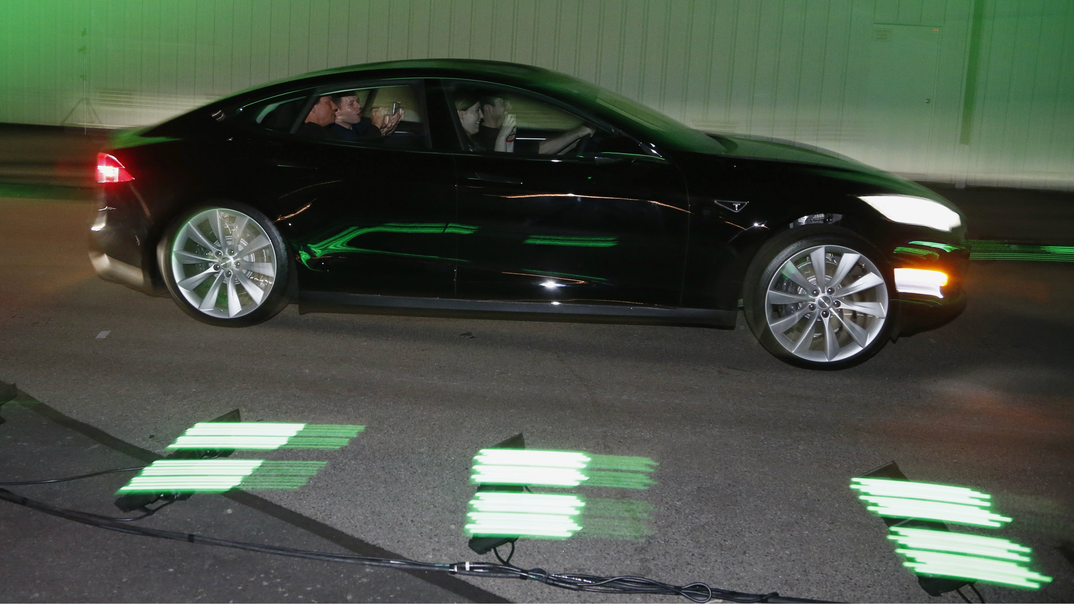 People test drive the new all-wheel-drive version of the Tesla Model S car in Hawthorne, California October 9, 2014.