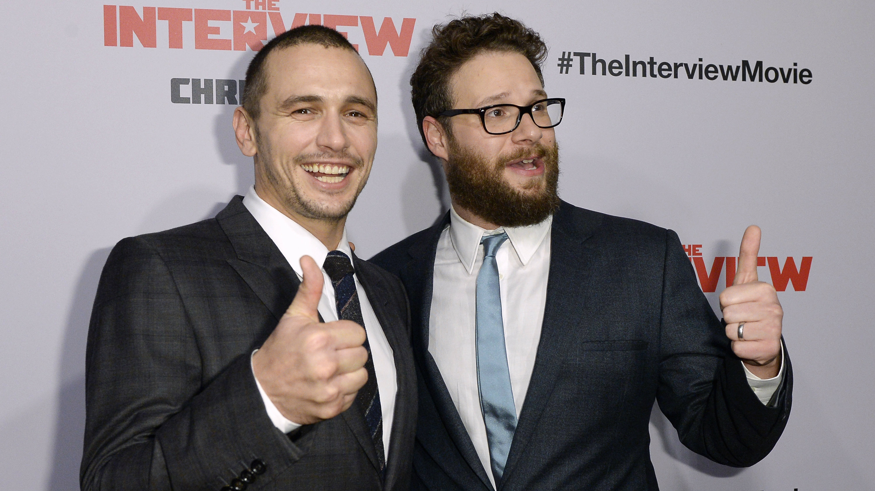 """DATE IMPORTED:December 12, 2014Cast members James Franco (L) and Seth Rogen pose during the premiere of the film """"The Interview"""" in Los Angeles, California December 11, 2014. REUTERS/Kevork Djansezian ("""