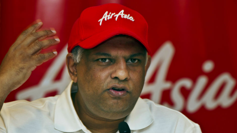 AirAsia's Chief Executive Tony Fernandes gestures during a press conference in New Delhi, India, Wednesday, July 3, 2013.