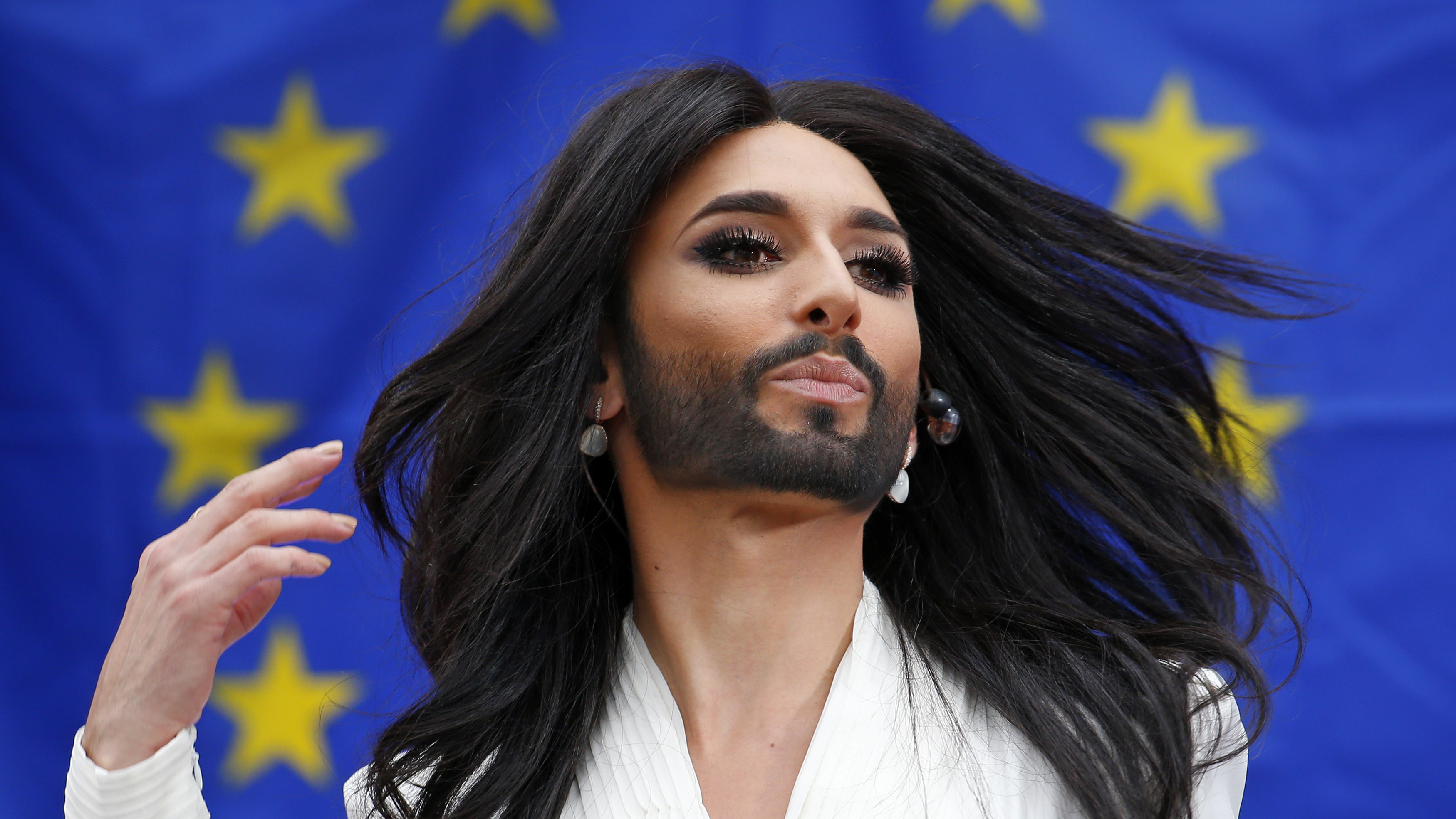 Conchita Wurst, the bearded transgender winner of the Eurovision Song Contest, performs during a concert at the European Parliament in Brussels October 8, 2014. The concert organised by members of Parliament aimed to support the adoption in February of the report against homophobia and sexual discriminations. REUTERS/Yves Herman (BELGIUM - Tags: POLITICS ENTERTAINMENT) - RTR49DJA