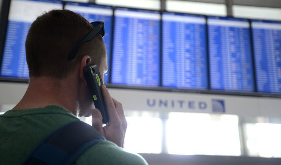 Dennis McCormack of Rockaway, N.J. checks the departure board only to find out that his flight to Newark, N.J. has been canceled at O'Hare International Airport in Chicago, Friday, Sept. 26, 2014. All flights in and out of Chicago's two airports were halted Friday after a fire at a suburban air traffic control facility sent delays and cancellations rippling through the U.S. air travel network. Authorities said the blaze was intentionally set by a contract employee of the Federal Aviation Administration and had no ties to terrorism.   (AP Photo/Paul Beaty)