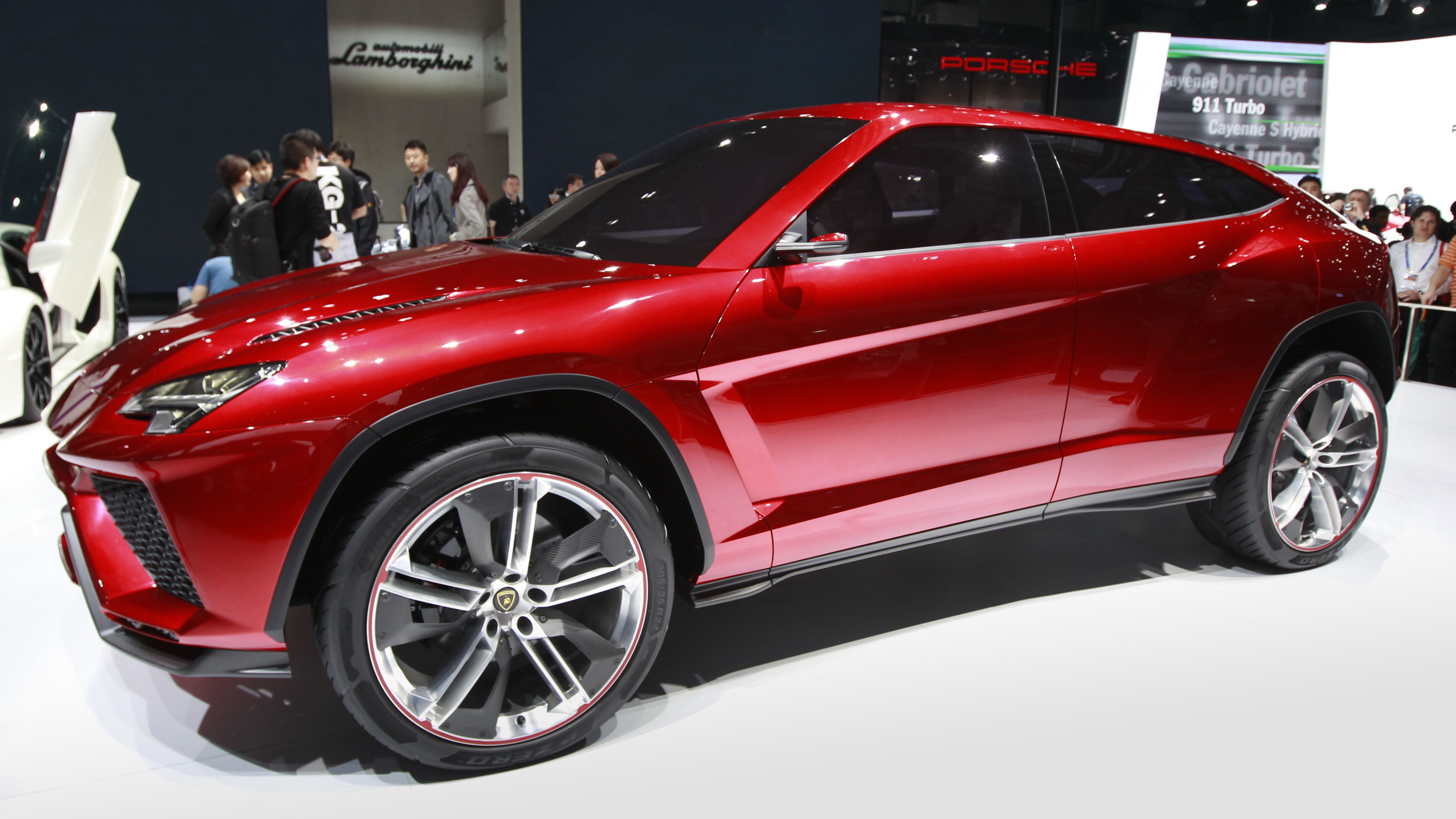 """Lamborghini's latest SUV """"Urus"""" is on display at the Beijing International Automotive Exhibition in Beijing, China, Tuesday, April 24, 2012. (AP Photo/ Vincent Thian)"""