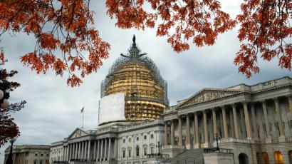 FILE - This Nov. 13, 2014, file photo shows the U.S. Capitol Dome, in Washington, surrounded by scaffolding for a long-term repair project, and framed by the last of autumn's colorful leaves. Like a student who waited until the night before a deadline, lawmakers resuming work Monday will try to cram two years of leftover business into two weeks while avoiding a government shutdown.