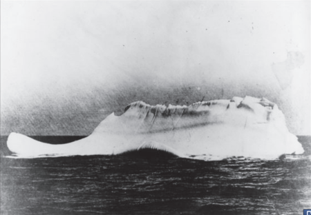 A scanned copy of the photographic print of the iceberg with which the RMS Titanic supposedly collided on April 14, 1912 at latitude 41-46N, longitude 50-14W. This print was in possession of Captain De Carteret, the Captain of the Minia, who reportedly stated that this was the only iceberg near the scene of the collision. The Minia was one of the first ships to reach the scene following the disaster.