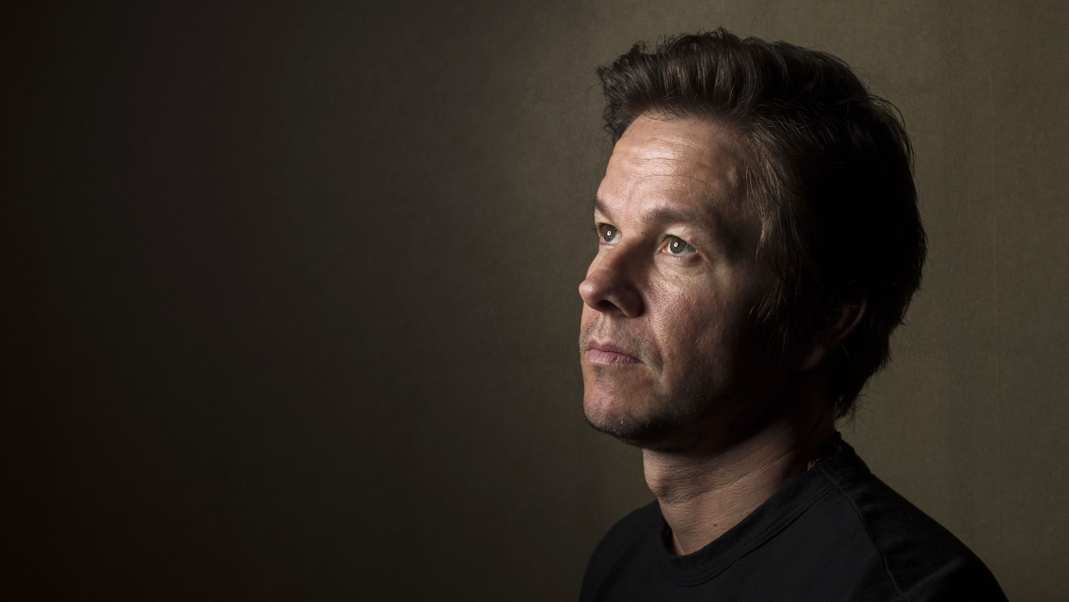 """Actor Mark Wahlberg poses for a portrait while promoting the film """"Lone Survivor"""" in New York December 5, 2013. The film is based on the memoir by former U.S. Navy SEAL Marcus Luttrell about the 2005 mission """"Operation Red Wings"""" in Afghanistan. REUTERS/Lucas Jackso"""
