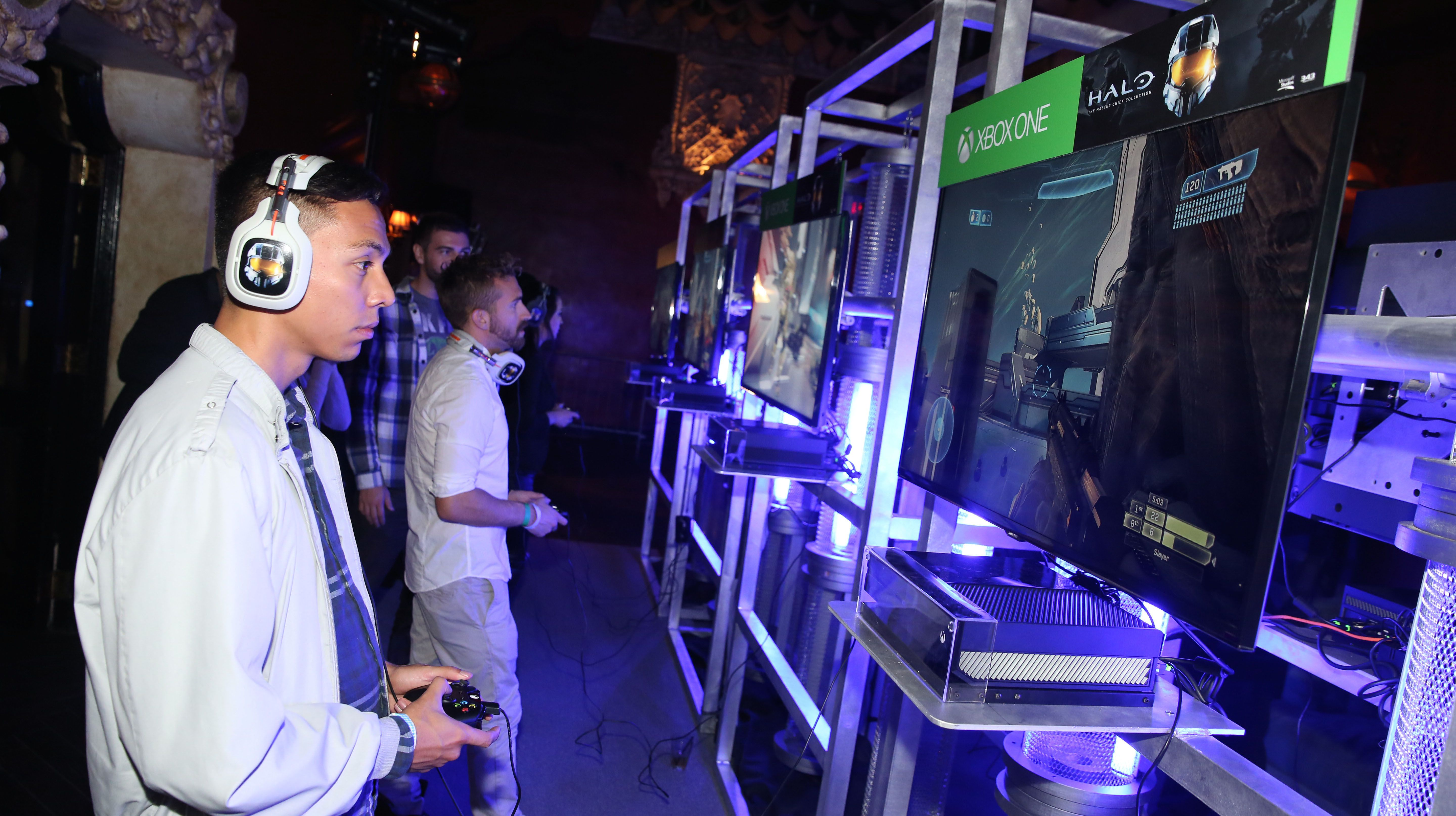 "Xbox fans play games from the popular ""Halo"" franchise at HaloFest at the Avalon Theatre in Los Angeles on Monday, Nov. 10, 2014. (Photo by Matt Sayles/Invision for Microsoft/AP Images)"