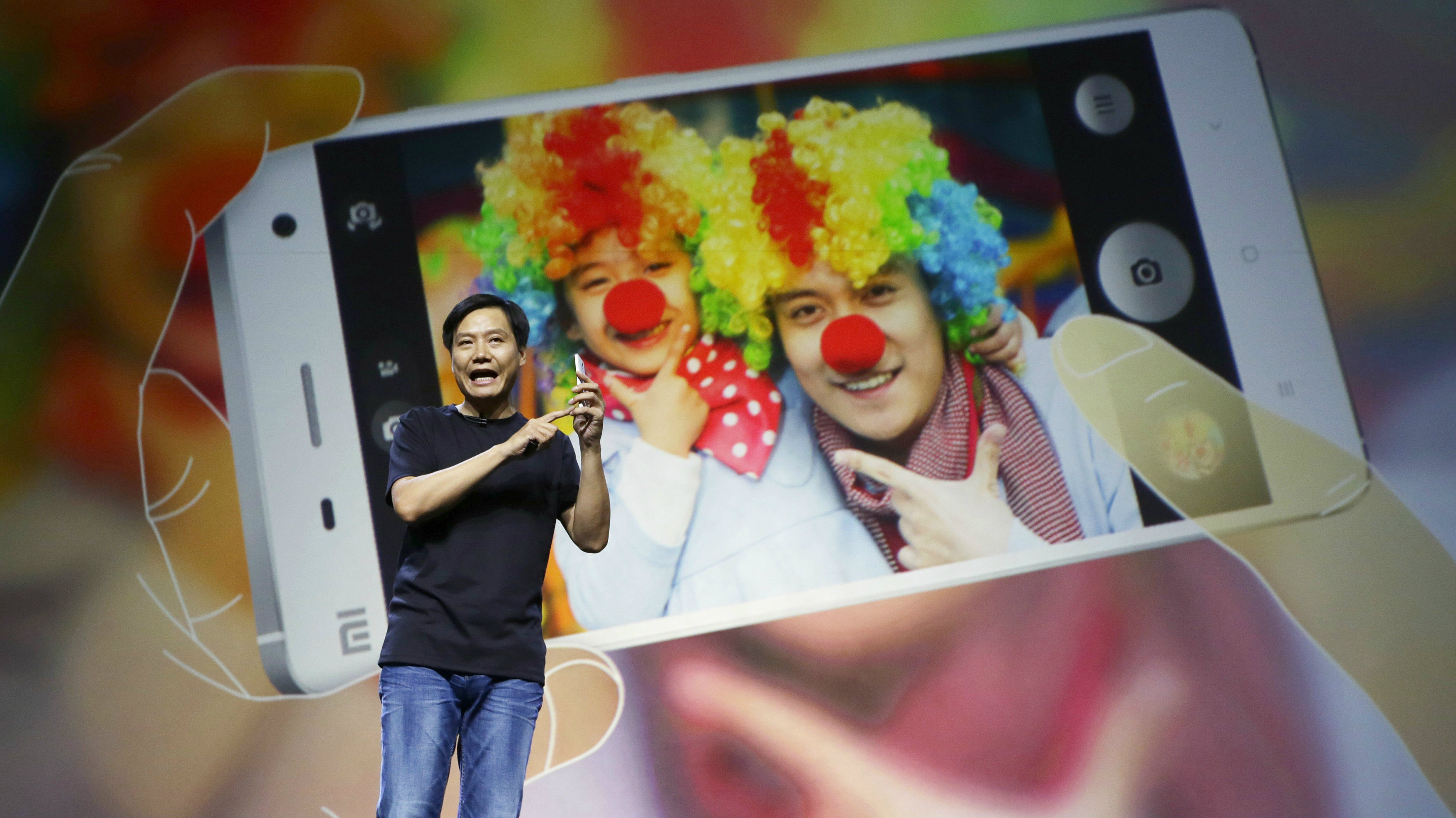 Lei Jun, founder and chief executive officer of China's mobile company Xiaomi, demonstrates the new features of the new Xiaomi Phone 4 at its launching ceremony, in Beijing July 22, 2014. China's Xiaomi Inc took China's smartphone crown in the second quarter after the Beijing-based firm replaced Samsung Electronics Co Ltd as China's largest smartphone vendor, according to data from Canalys. Picture taken on July 22, 2014.