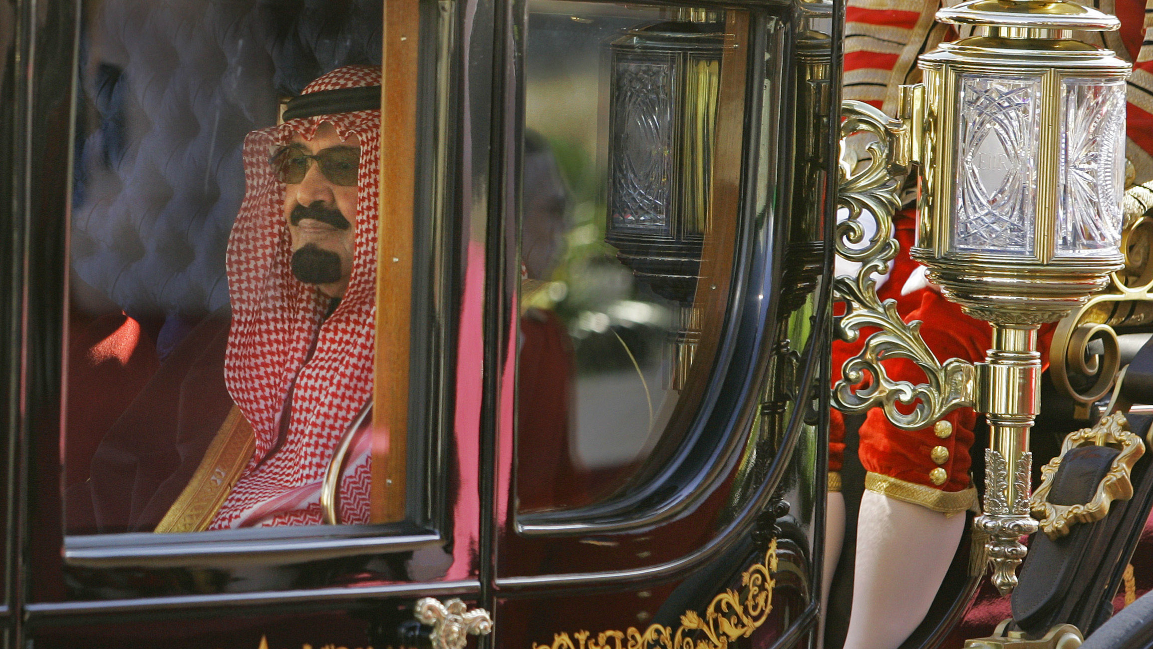 Saudi Arabia's King Abdullah rides in a carriage as he leaves Horse Guards, London, after a ceremonial welcome October 30, 2007.