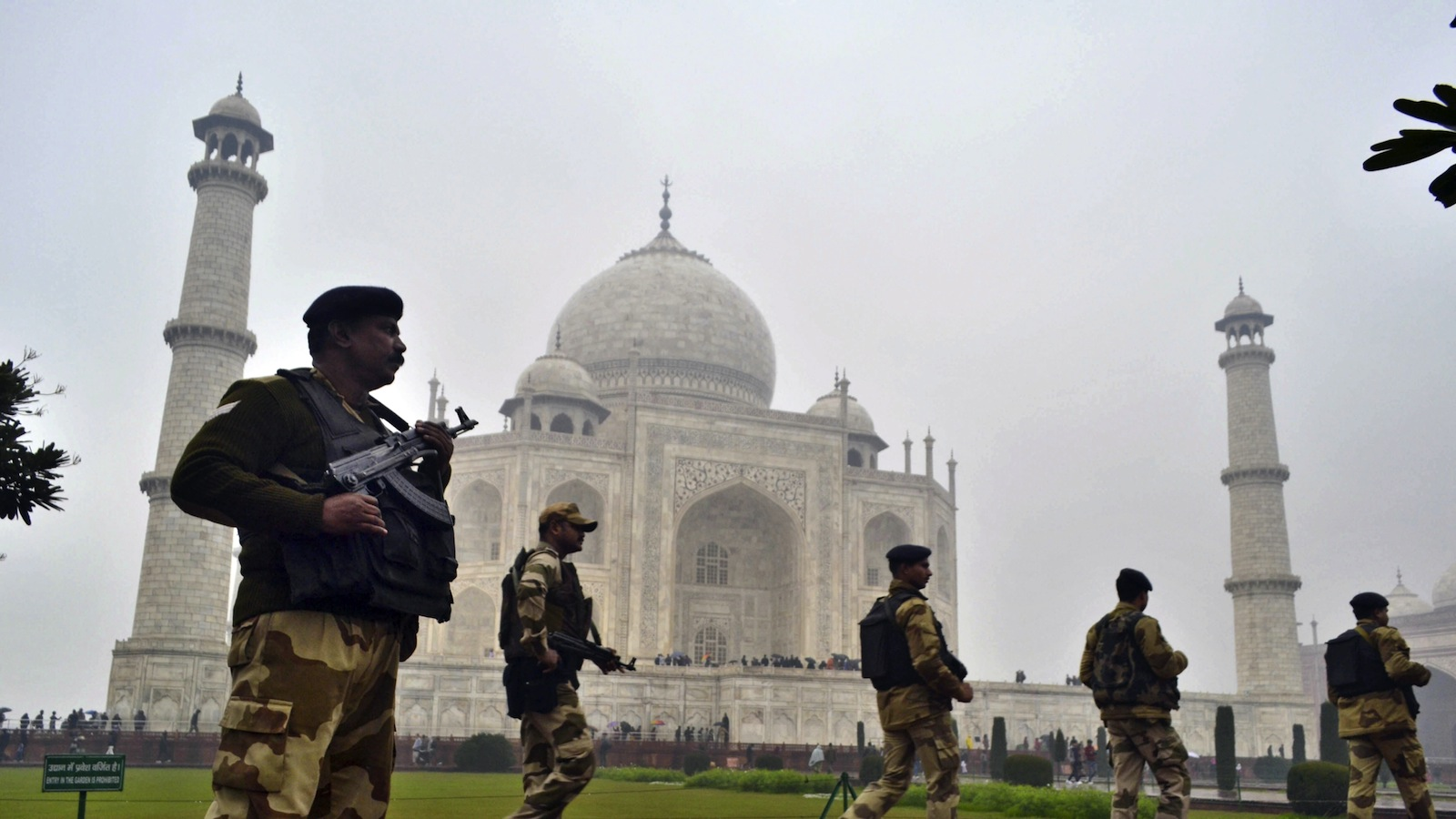 In this Jan. 22, 2015 file photo, Central Industrial Security Force (CISF) personnel keep a watch on the surroundings at the Taj Mahal before U.S. President Barack Obama's planned visit in Agra, India. Obama has canceled his visit to the Taj Mahal that had been planned on the final day of his trip to India, officials said Saturday, Jan. 24. (AP Photo/Pawan Sharma)