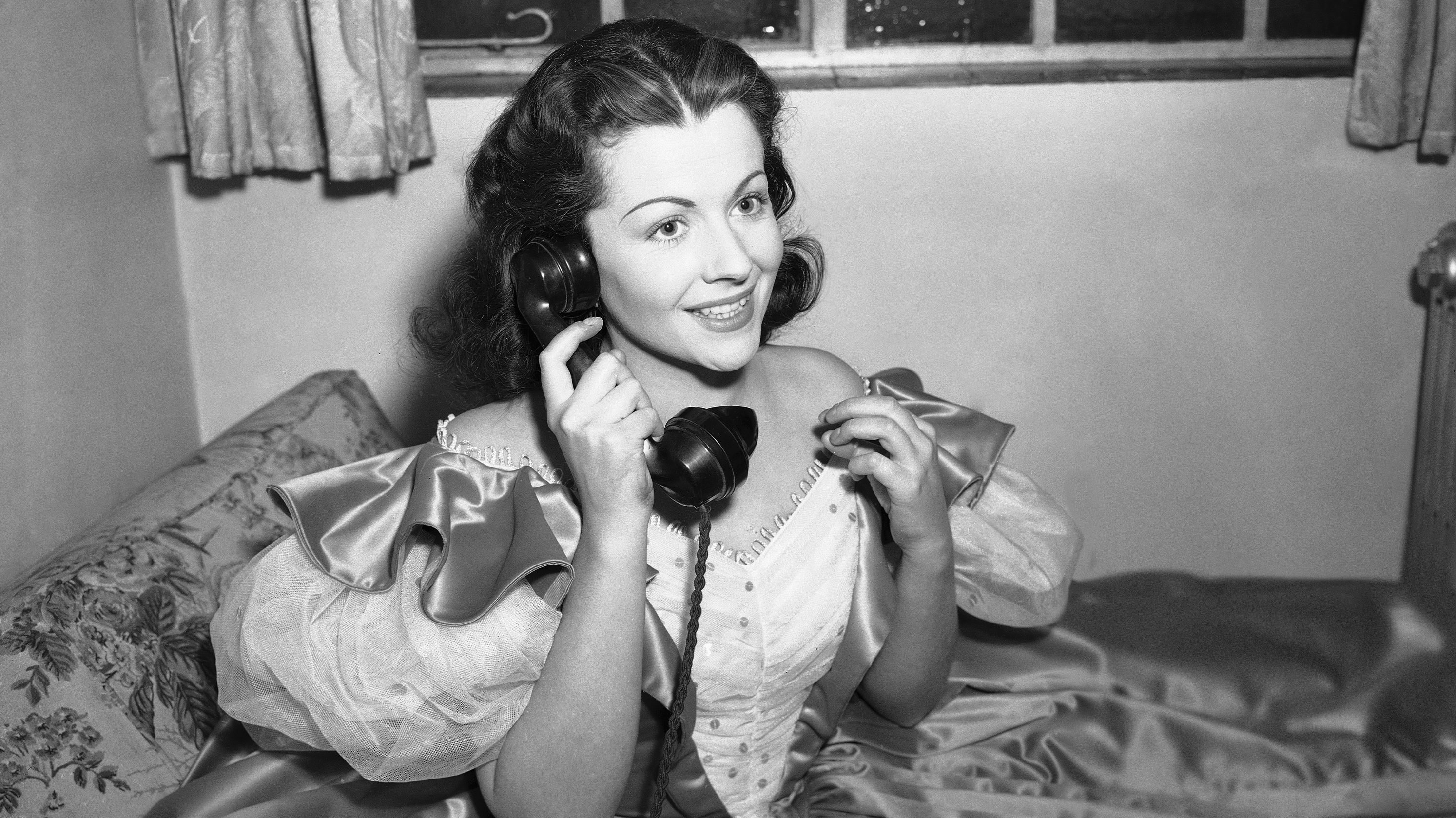 """Margaret Lockwood, star of the film """"The Wicked Lady"""" during a series of trans-Atlantic telephone interviews with American newspapers on Dec. 4, 1946. The film is about to have its first showing in the USA. In her first interview on December 4, Miss Lockwood answering the question on what she thought about American censorship, to which she replied that Queen Mary saw the picture in London and was delighted with it, adding, that if it didn't shock Queen Mary, I don't see why it should have shocked Joseph Breen, the censor. (AP Photo)"""