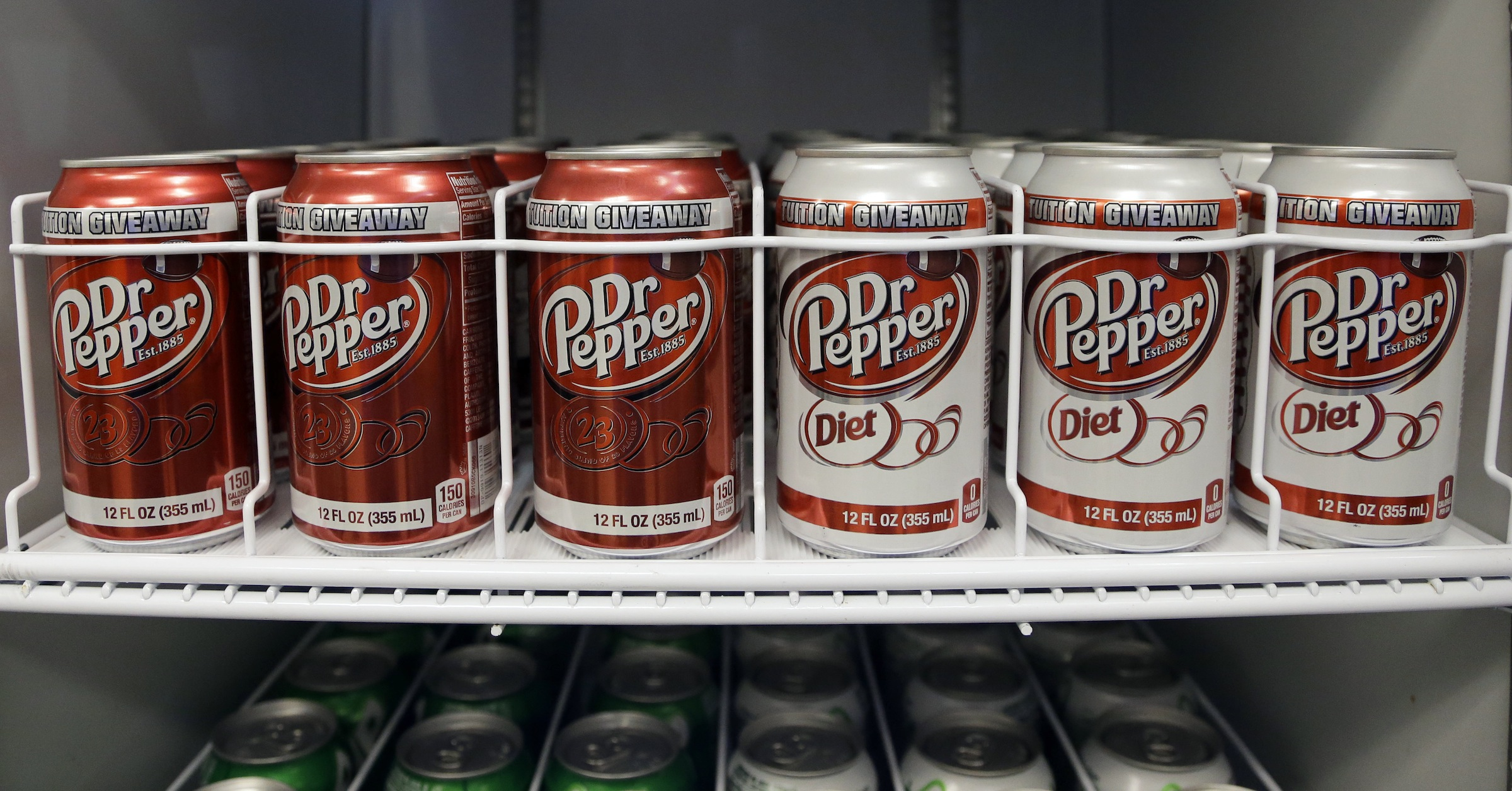 In this  Oct. 6, 2013, photo, Dr. Pepper are refrigerated, at the soldier field  in Chicago. Dr. Pepper reports quarterly earnings on Wednesday, Oct. 23, 2013. (AP Photo/Nam Y. Huh)