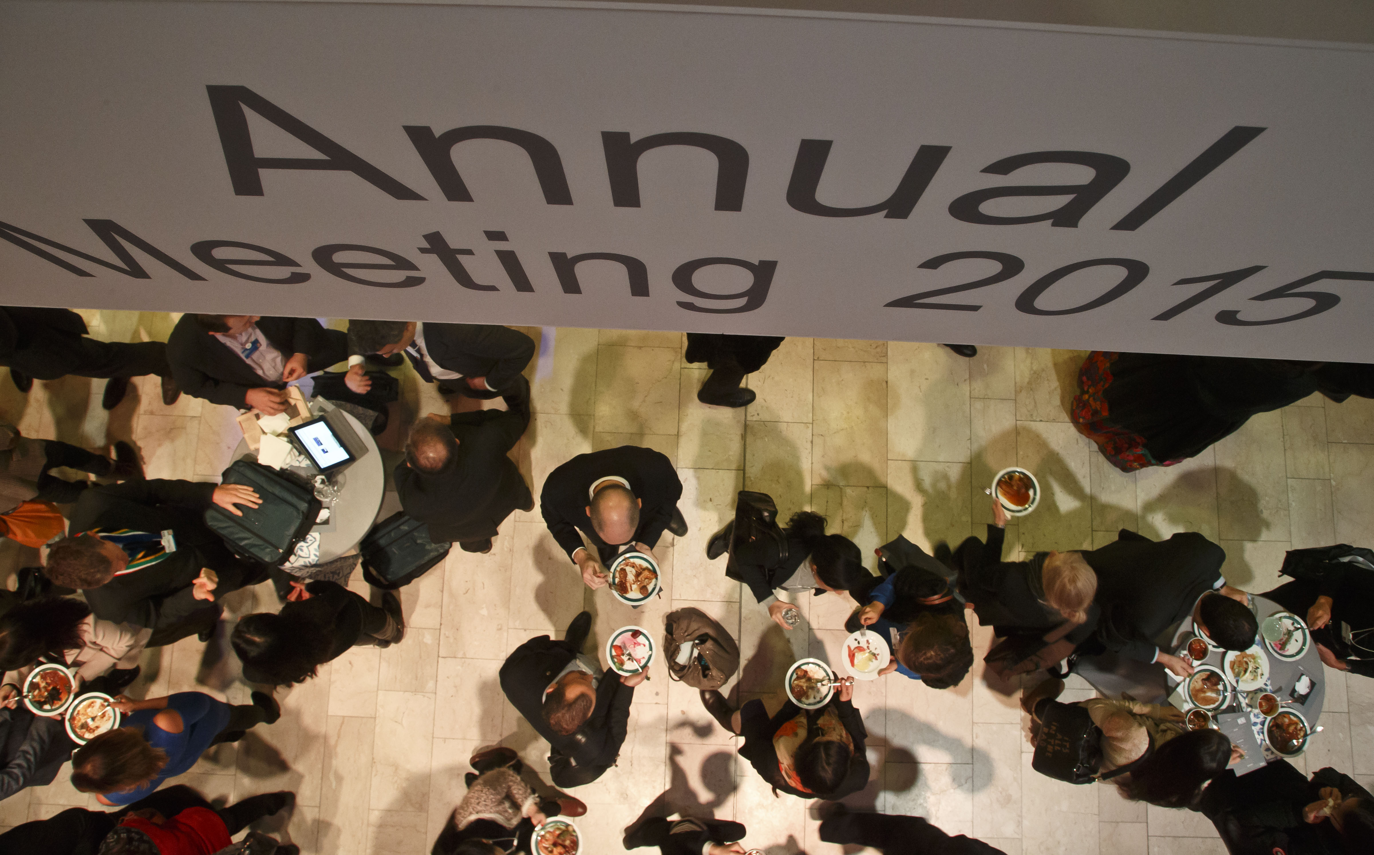 Participants gather during lunch time at the World Economic Forum in Davos, Switzerland, Saturday, Jan. 24, 2015. The world's financial and political forum at the Swiss ski resort will end today. (AP Photo/Michel Euler)