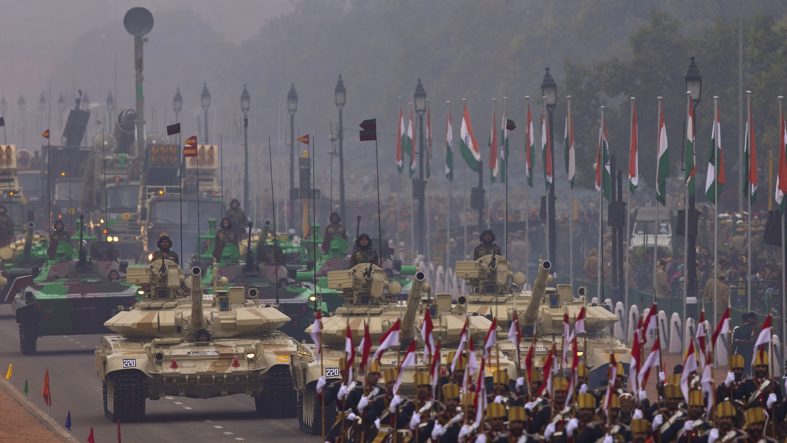 T-90 tanks roll down Rajpath, a ceremonial boulevard that runs from Indian President's palace to war memorial India Gate, as part of the full dress rehearsal ahead of Republic Day parade in New Delhi, India, Friday, Jan. 23, 2015. U.S. President Barack Obama will be the chief guest during this year's parade which will be held on Jan. 26. (AP Photo/Saurabh Das)
