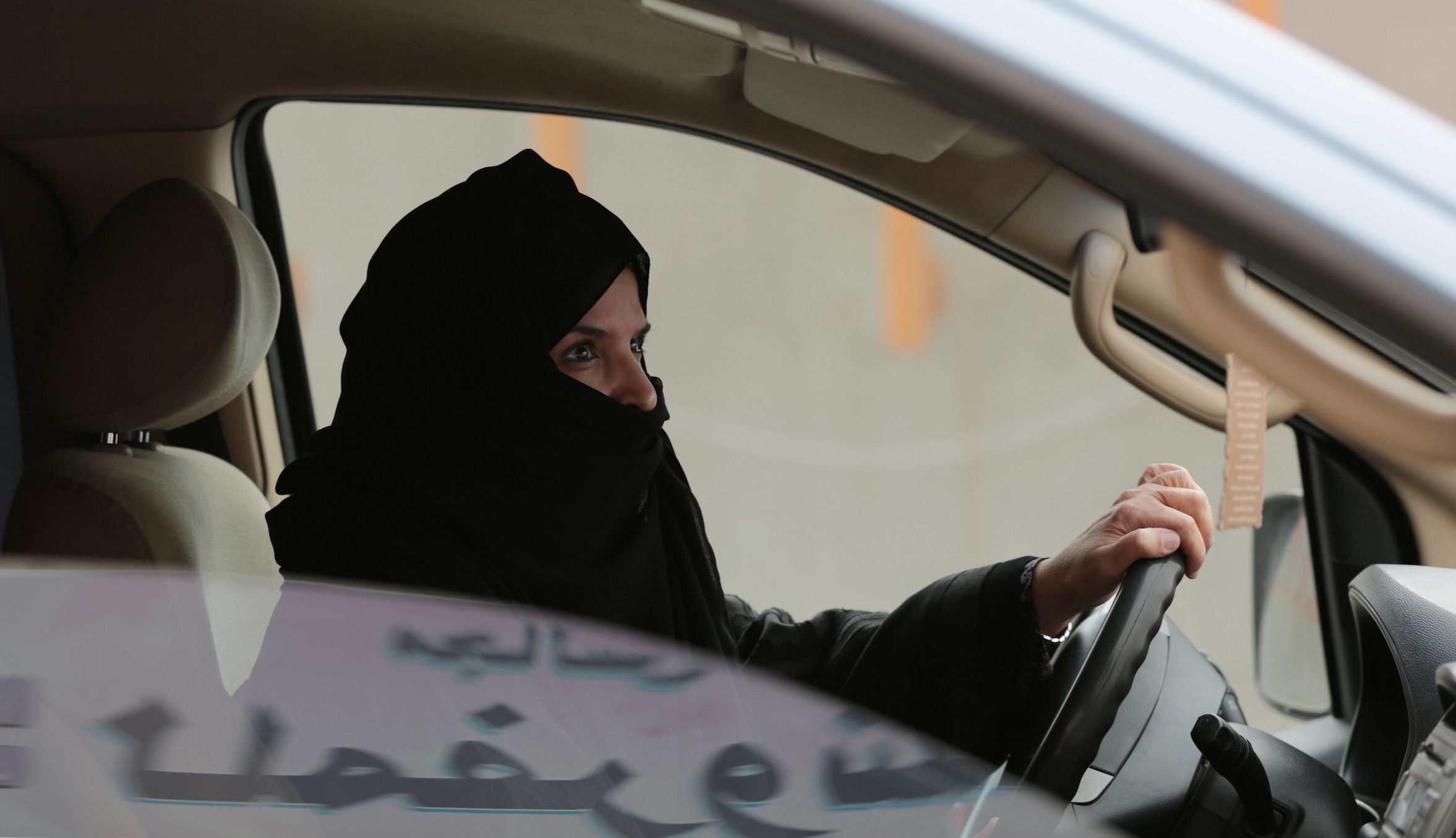 FILE - In this Saturday, March 29, 2014 file photo, Aziza Yousef drives a car on a highway in Riyadh, Saudi Arabia, as part of a campaign to defy Saudi Arabia's ban on women driving. Single Saudi women stand at the center of a societal pivot. On the one hand, the kingdom has increasingly encouraged women to graduate from college and enter the workforce. On the other hand, it still requires that they adhere to laws that give men final say over their lives. Over the past three decades until around 2009, the number of Saudi women working was less than 50,000, but is now more than 400,000, according to the Labor Ministry.  (AP Photo/Hasan Jamali, File)
