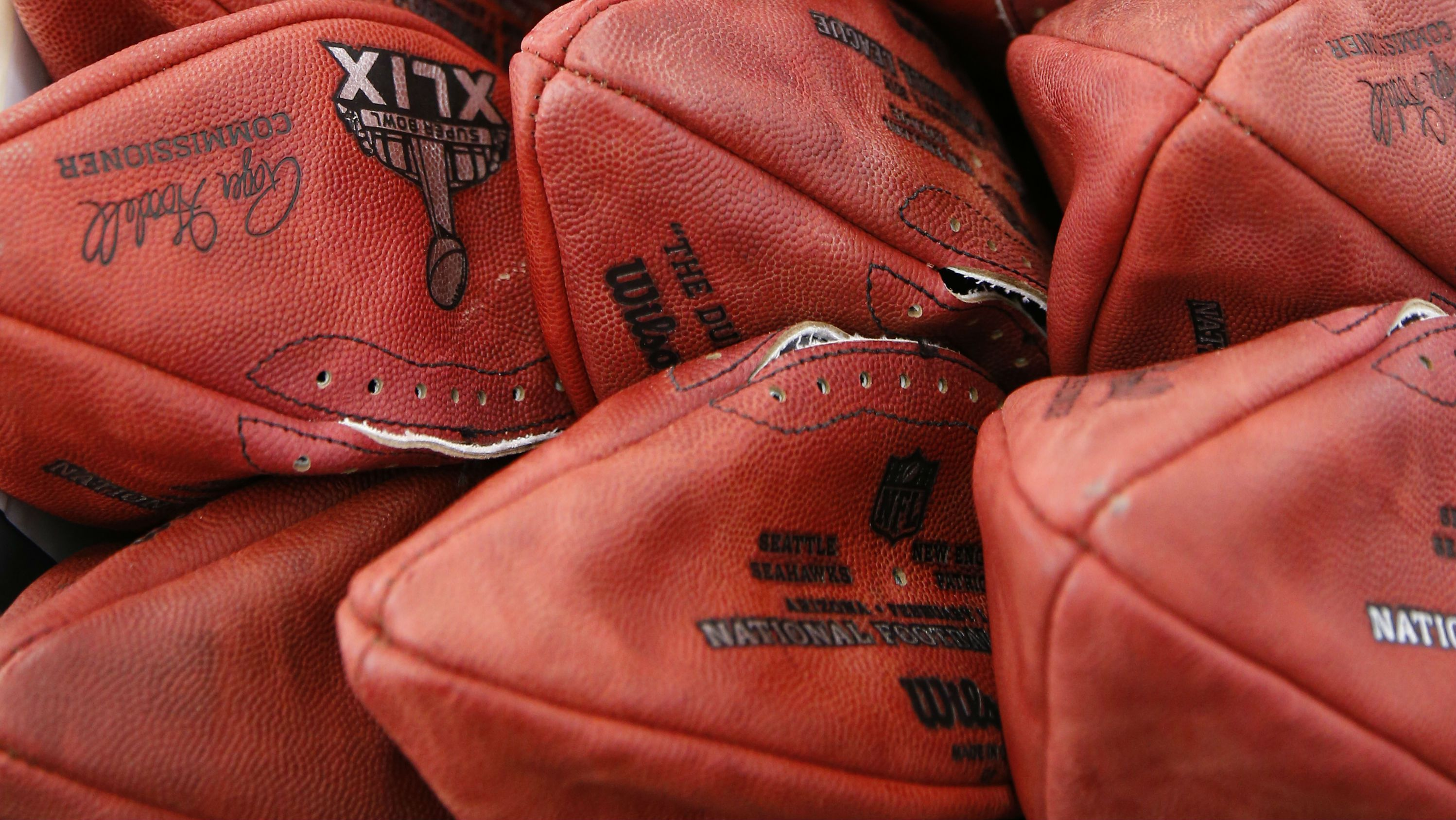 Official game balls for the NFL football Super Bowl XLIX sit in a bin before being laced and inflated at the Wilson Sporting Goods Co. in Ada, Ohio, Tuesday, Jan. 20, 2015. The New England Patriots will play the Seattle Seahawks in the Super Bowl on Feb. 1 in Glendale, Arizona. (AP Photo/Rick Osentoski)