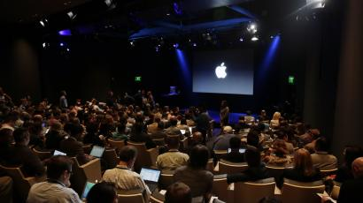 Attendees wait for the start of an event at Apple headquarters on Thursday, Oct. 16, 2014 in Cupertino, Calif. (AP Photo/Marcio Jose Sanchez)