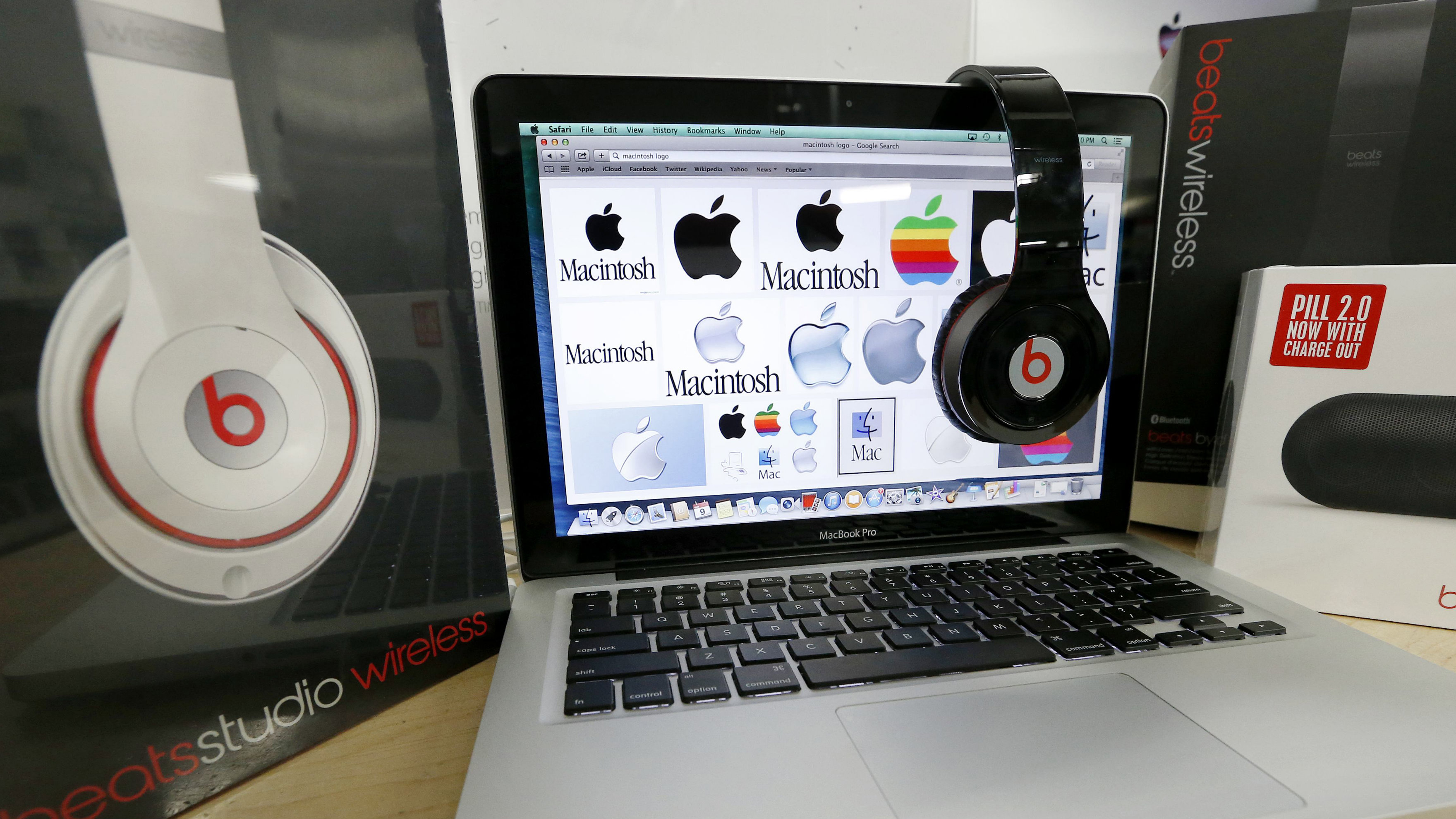 Beats Audio equipment is arranged for a photo next to an Apple laptop at Best Buy in Boston, Friday, May 9, 2014. Apple is orchestrating a $3.2 billion acquisition of Beats Electronics, the headphone maker and music streaming distributor founded by hip-hop star Dr. Dre and record producer Jimmy Iovine, according to a Financial Times report published late Thursday, May 8, 2014.