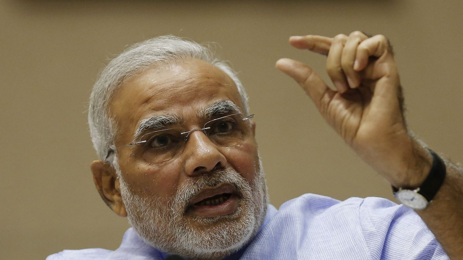Indian Prime Minister Narendra Modi speaks during the launch of the Jan Dhan Yojana, or the Scheme for People's Wealth, in New Delhi August 28, 2014. Under the banking scheme, account holders would get a debit card and accident insurance cover of up to 100,000 rupees ($1,654). They would also get an overdraft facility of up to 5,000 Indian rupees.