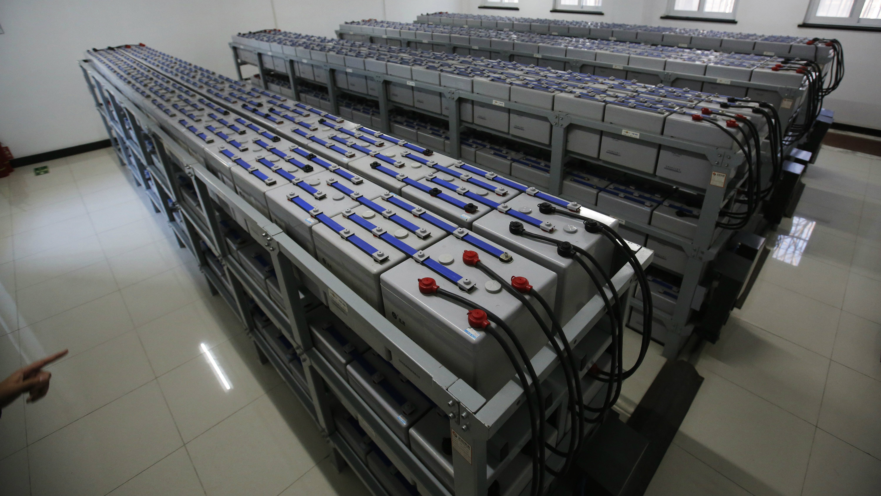 Batteries saving electricity produced by solar power is seen at PetroChina's Yizhuang gas station which has solar power system in Beijing January 9, 2015.
