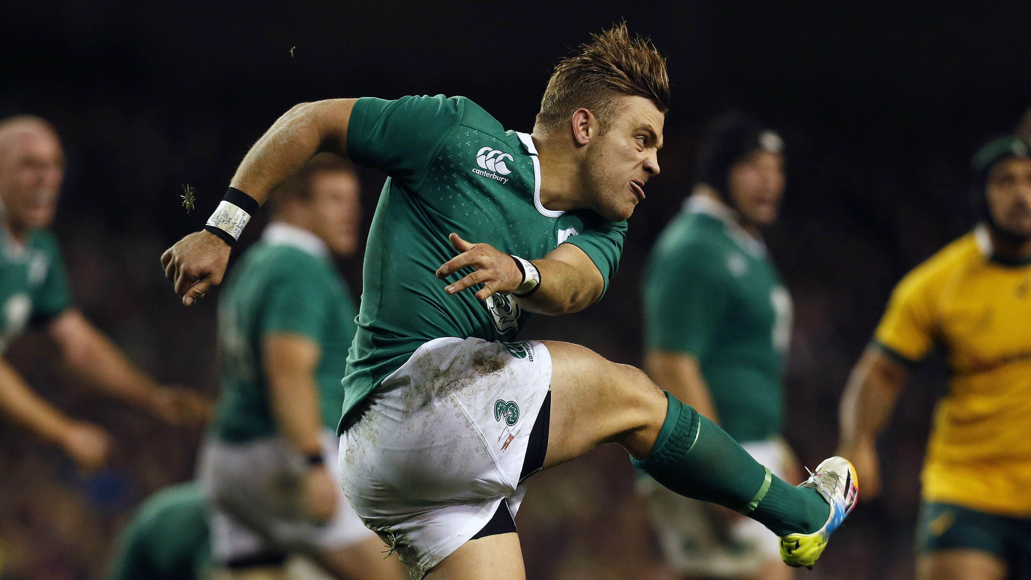 Ireland's Ian Madigan clears the ball against Australia during their international rugby test match at the Aviva Stadium in Dublin November 22, 2014. REUTERS/Cathal McNaughton (IRELAND - Tags: SPORT RUGBY)