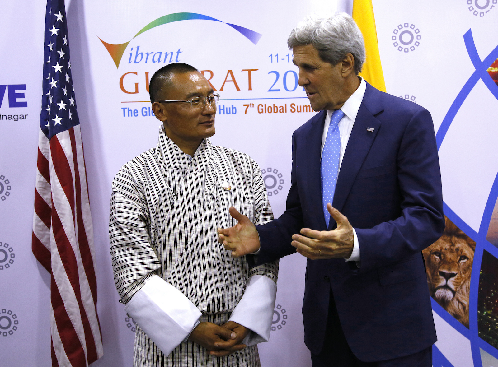 U.S. Secretary of State John Kerry (R) meets with Prime Minister of Bhutan Tshering Tobgay in Ahmedabad January 11, 2015.